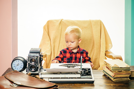 Vintage is real class. Little boy type paper on vintage typewriter Stock Photo