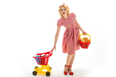 happy retro woman go shopping. savings on purchases shopping girl with full cart. vintage housewife woman isolated on white. happy woman in shop. Modern woman. After shopping. It is bargain