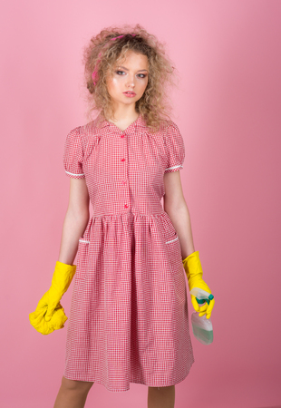 Housewife ready to clean house. Pretty girl clean in rubber gloves with cloth and detergent. I keep my house really good
