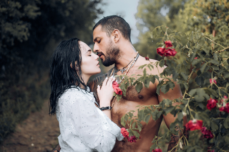 Sensual couple kiss. First love. Hugs together and sensual touch. Intimate relationship and sexual relations. Passionate lover caressing arousing beautiful woman. Woman with muscular latin lover.