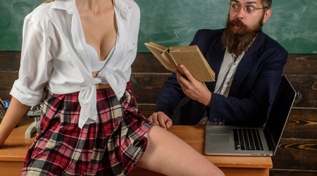 First love. Sex protect and sexual life. Man Sexually Harassing woman. Sexy education. Bearded sexology teacher looks at sexy female students. Erotic education and sex Symbols on chalkboard. Archivio Fotografico - 108575643