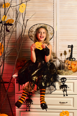 Happy little girl enjoy halloween. Little girl wear witch costume on halloween. I witch you a happy halloween. Haunting beauty