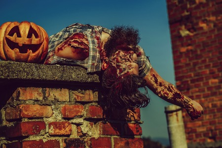 Zombie man lies on chimney