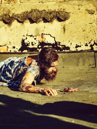 Zombie man lies on asphalt Banco de Imagens