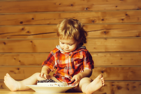 Cute boy eats cake