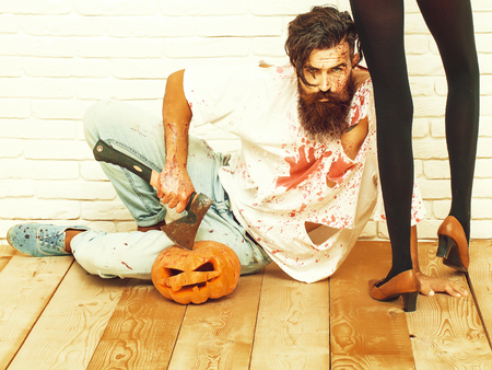Zombie man and female legs Imagens
