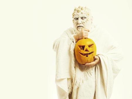 Man with orange pumpkin Stockfoto