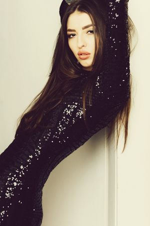 Beautiful slim model in sequin black dress Stock Photo