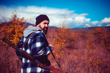 Vintage hunter. Hunting without borders. Hunter with shotgun gun on hunt. Autunm hunting. Hunting in Russia. Autumn.