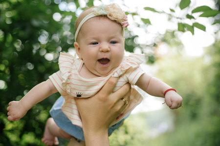 Lets fly on wings of love. Happy newborn baby. Newborn baby smile in parents hands. Happy family. Keep calm and love your family