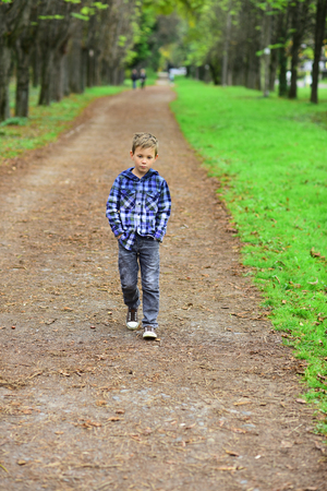 Im looking forward to the future. Little boy enjoy a brighter future. Little boy walk along footpath in park. Preparing for the challenges of the future. The future is in my power
