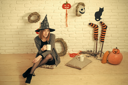 Halloween woman in witch hat with cups