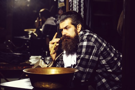 bearded man with razor and bowl