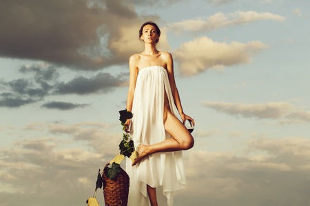 pretty girl with wine bottle over sky