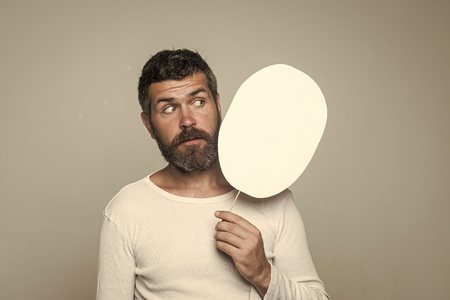 Guy or bearded man on grey background.