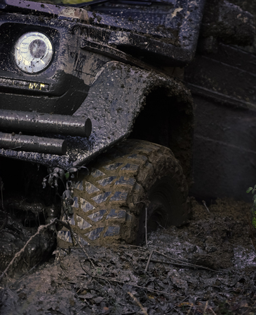 Extreme entertainment concept. Offroad tire covered with mud 写真素材