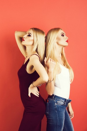 women twins, friends with bright makeup Stock Photo