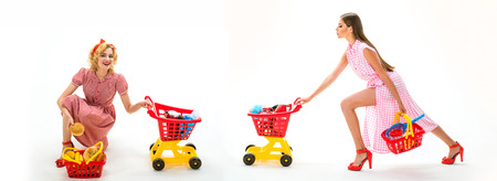 retro women go shopping with full cart. happy shopping girls with full cart. savings on purchases. online shopping app. vintage housewife women going to make payment in supermarket. home delivery