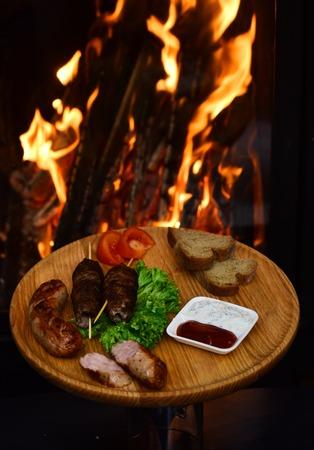 Shashlik or shish kebab on wooden board. Shashlik grilled meat skewered on sticks traditional georgian dish at burning fire. For hungry people 版權商用圖片