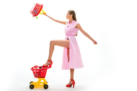 Riding a shopping cart. Carefree fun. Quality time. Joyful retro woman enjoying online shopping. big sale in shopping mall. selling consumer goods or services to customers. retail service.