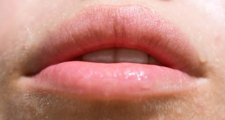 Sexy wet lips. Sexy lips temptation. Moisturize and hydrate. Falling into temptation. Moisturize and give a wet lips effect Stock Photo