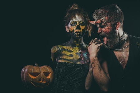 Halloween girl with skull makeup and hipster devil show tongue