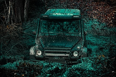 Safari suv. Travel concept with big 4x4 car. Off the road travel on mountain road. Expedition offroader. Track on mud. 4x4 Off-road suv car. Offroad car. Safari.