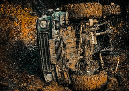 Travel concept with big 4x4 car. Off the road travel on mountain road. Track on mud. Reklamní fotografie