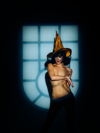 Night time halloween party for adult. Sexy Woman with pumpkins. vampire girls. Sunsual desire concept. Halloween lingerie model.