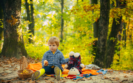 Childhood friendship and first memories. Camping with kids. Little boy in trendy vintage blue pullover or sweater.