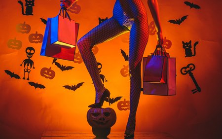 Female with sexy ass posing on pumpkin. Erotic lady fashion concept. Autumn time for Fashion sale. Halloween poster with pumpkins. Secrets of Magic for Happy Halloween. Stock Photo - 110541576