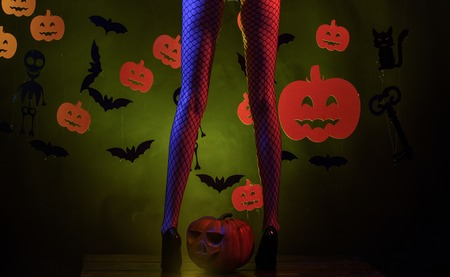 Womens clothing store celebrates Halloween. The Most Popular Candy for Halloween. Female with sexy ass posing. Sexy Horror background. Sexy Model Posing In Lingerie on halloween background.