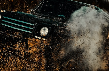Travel concept with big 4x4 car. Rally racing. Tracks on a muddy field. Off-road vehicle goes on the mountain. Expedition offroader. Stock Photo - 110541505