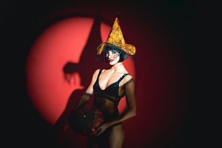 Halloween lingerie model. Sexy Woman with pumpkins. vampire girls. Sunsual desire concept. Reklamní fotografie