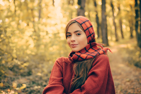 Enjoying good weather. Pretty woman walking in the Park and enjoying the beautiful autumn nature. cute girl in good mood posing in autumn day. Happy girl in Autumn Park. Stock fotó