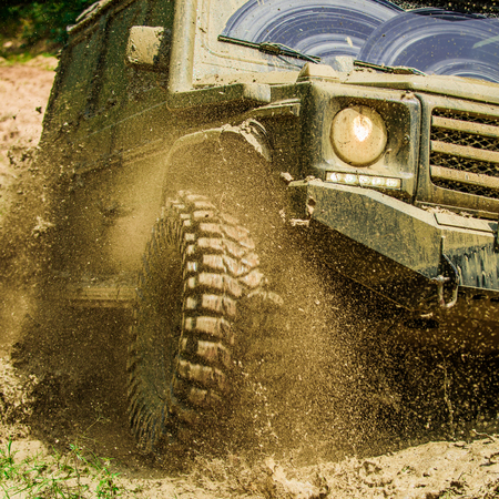 Off-road travel on mountain road. Travel concept with big 4x4 car. Mud and water splash in off-road racing. Motion and power concept. Stock Photo - 110472440