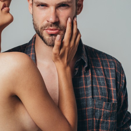 Touch face. Healthy skin care handsome man. Cleansing skin in the morning. Skin type for cleaning skin. Romantic couple is kissing and enjoying the company of each other at home. Stock Photo