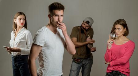 Smoking addiction. Actual social problem. Drug addict or medical abuse concept. Sad man with depression looking in camera. Zdjęcie Seryjne