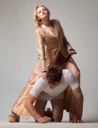 Dominant womans. Dominantning in the foreplay sexual game. Shop with Bondage and bdsm. Woman and man playing domination games.