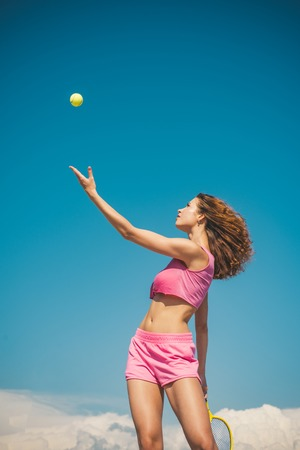 Girl playing tennis. Happy active female workout. Beautiful attractive fitness woman. Tennis concept. Sport and healthy lifestyle.