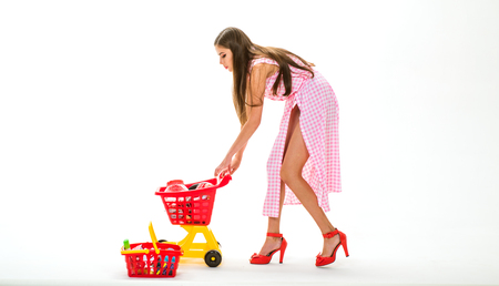 Buying and selling. It is perfect. What do you think about this. retro woman buy products for family isolated on white. vintage woman with shopping cart. cyber monday. fashion woman shopaholic