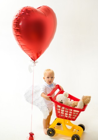 valentines day and love. shopping for children. happy childhood and care. little boy go shopping with full cart. little boy child in toy shop. saving on purchases. Why not. Excitement. Shopping alone