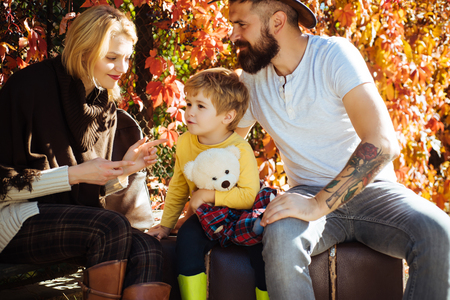 Autumn camping with kids, mom and father. Happy family concept. Little traveler and happy parents traveling together.
