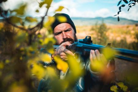 Close up snipers carbine at the outdoor hunting. Man holding shotgun. Hunter with shotgun gun on hunt. Deer hunt. Reklamní fotografie - 110836012