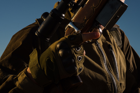 Hunter with shotgun gun on hunt. Hunting Equipment for sale.