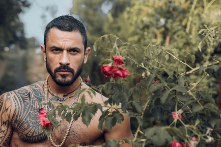 Handsome muscular latinos man ready to Happy Valentines Day. Man in red roses and women