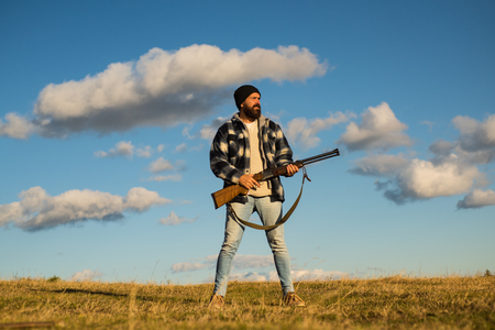 Hunting without borders. Hunter with shotgun gun on hunt. Closed and open hunting season. Stock Photo