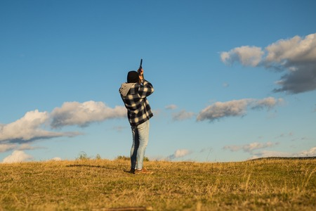 Sporting clay and skeet shooting. Hunter with shotgun gun on hunt. Hunter in the fall hunting season.