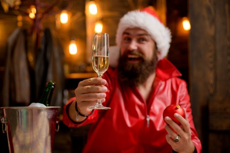 Santa wishes Merry Christmas. Portrait of a brutal mature Santa Claus. Modern man in red santa claus suit. Banco de Imagens