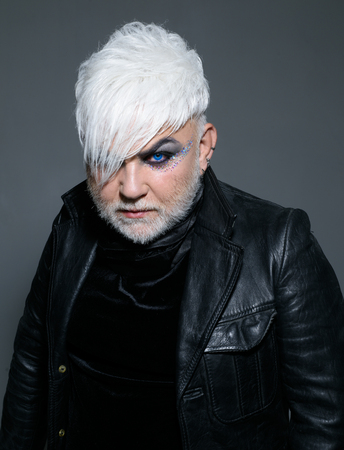 Free and queer. Transgender person. Exotic hipster man with fashion hairstyle. Hipster fashion style. Support transgender rights. Male makeup look. Bearded man with male makeup Standard-Bild - 111294247